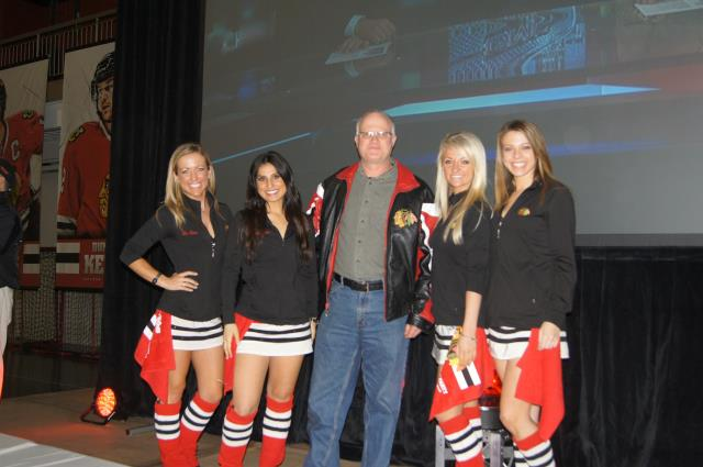 Steve Bosak of Libertyville Fan of the Game with Ice Crew Girls at Blackhawks Roadwatch Party at Libertyville Sports Complex April 9 2013